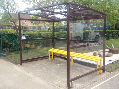 image of smoking shelter with perch seat